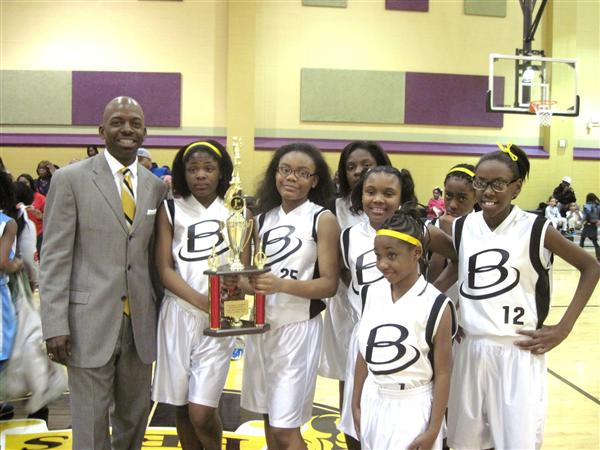 The Brown Sting Girls Basketball team wins the 2014-15 BCS Championship